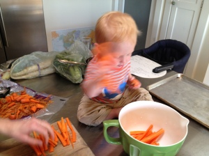 Ethan helping put carrots into the bowl